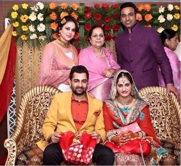 Sharry mann with his wife